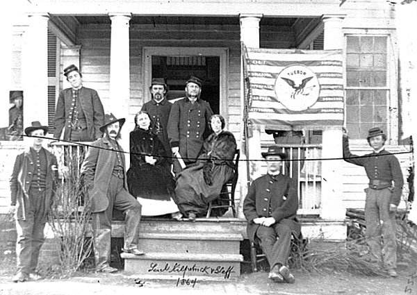 Judson Kilpatrick with ladies and staff members on the porch of headquarters